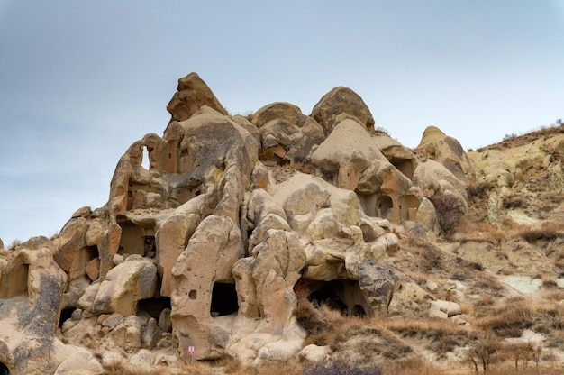 Cappadocia caves under cloudy sky