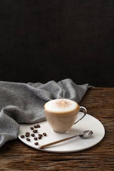 Cappuccino coffee clear cup on wood background  for cafe coffee shop menu