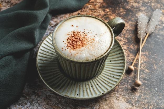 Cappuccino coffee mug on saucer.