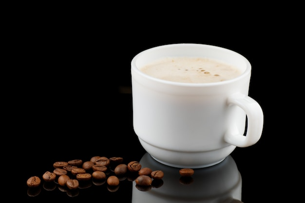 Cappuccino in a cup and coffee beans
