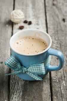 Cappuccino mug on wooden table