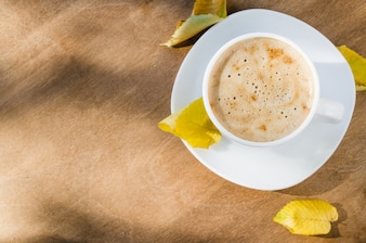 Cappuccino or coffee latte. Autumn concept.