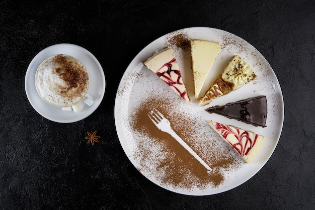 Cappuccino and three pieces of cheesecake, top view