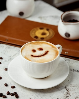 Cappuccino with cinnamon drawing on top