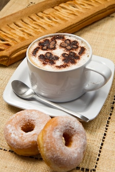 Cappuccino with donuts and strudel