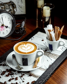 Cappuccino with flower picture on the table