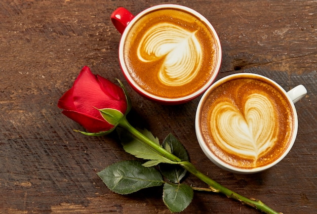 Cappuccino with red rose