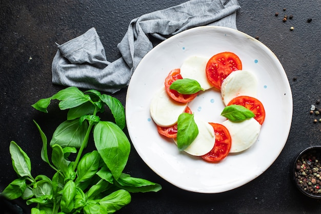 Caprese salad mozzarella cheese tomato meal snack copy space food background rustic top view
