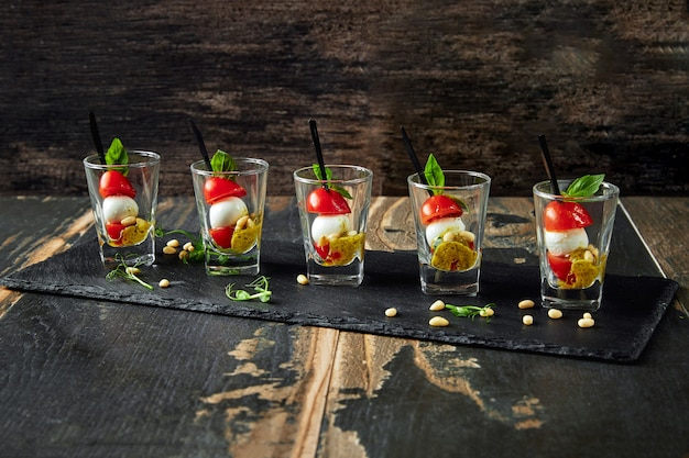 Caprese salad in a row - skewer with tomato, mozzarella and basil, italian food and healthy vegetarian diet concept