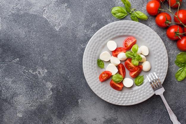 Caprese salad of tomatoes, mozzarella cheese and basil. italian cuisine. copy space