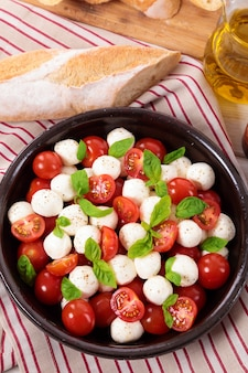 Caprese salad with mozzarella cheese and basil