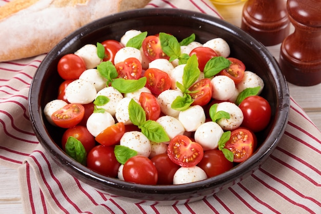 Caprese salad with mozzarella cheese in a bowl