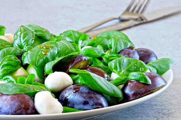 Caprese salad with plums. healthy salad. keto diet.