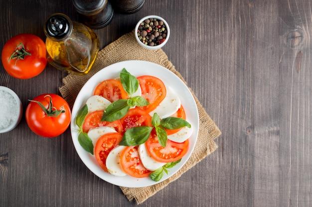 Caprese salad with tomatoes, basil, mozzarella cheese.