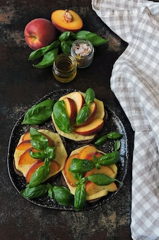 Caprese toast with peach, cheese and basil