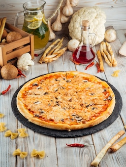 Capricciosa pizza with chicken fillet and mushroom