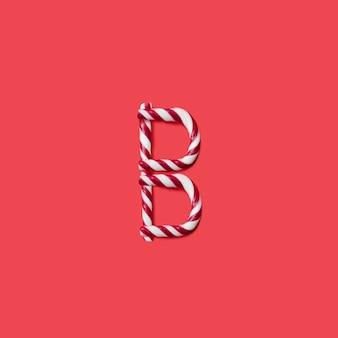 캡 사탕과 설탕 글꼴. 문자 b