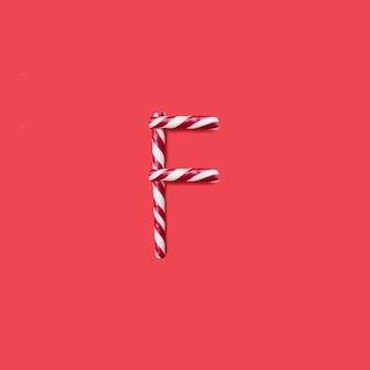 캡 사탕과 설탕 글꼴. 편지 f