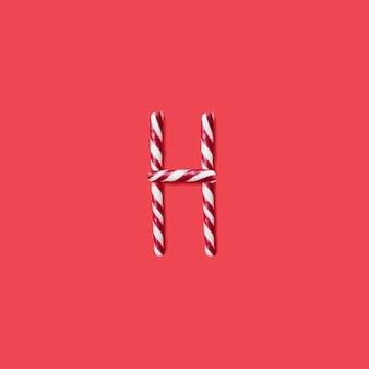 캡 사탕과 설탕 글꼴. 편지 h