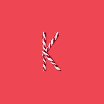 캡 사탕과 설탕 글꼴. 편지 k