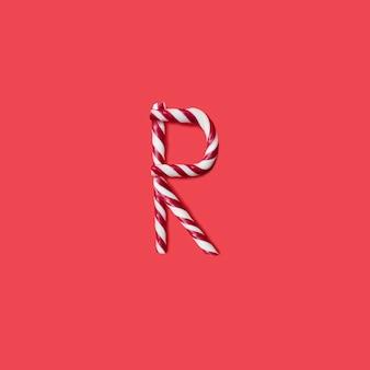캡 사탕과 설탕 글꼴. 편지 r