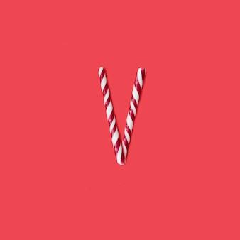 캡 사탕과 설탕 글꼴. 편지 v