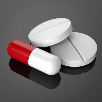 黒の背景にカプセルと錠剤の丸薬