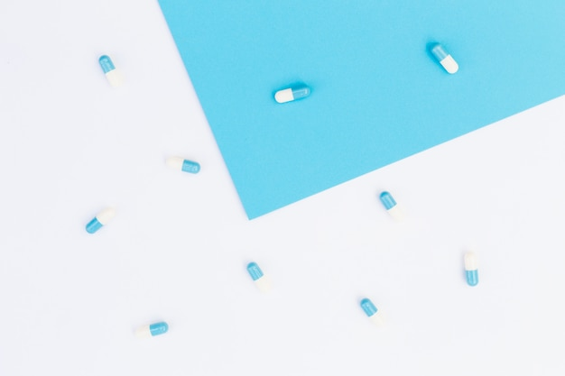 Capsules on blue and white background