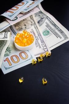 Capsules of fish oil and dollars