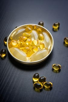 Capsules of fish oil in gold cup