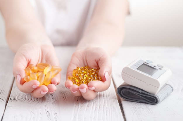 Capsules of fish oil and vitamin e protection from heart diseases