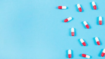Capsules on blue background