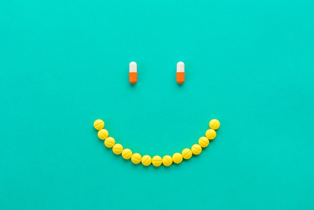 Capsules and pills arranged in smilng face