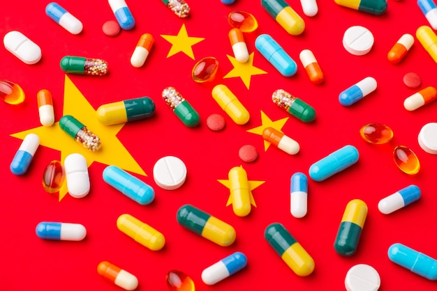 Capsules and tablets on flag of china