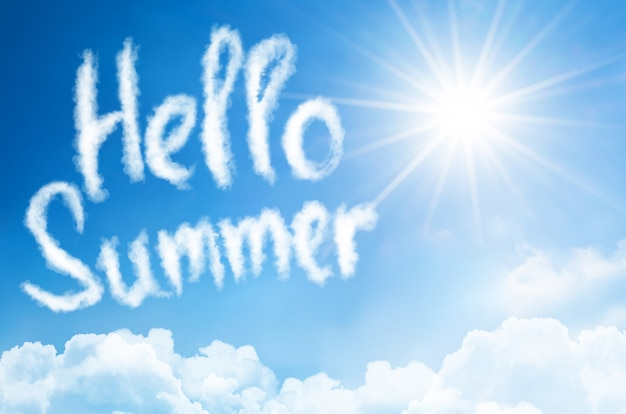 Caption text message - hello summer, against a background of a sun shine tinted blue summer sky with clouds below.