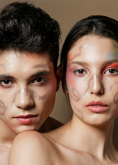 Captivating couple posing with painted faces