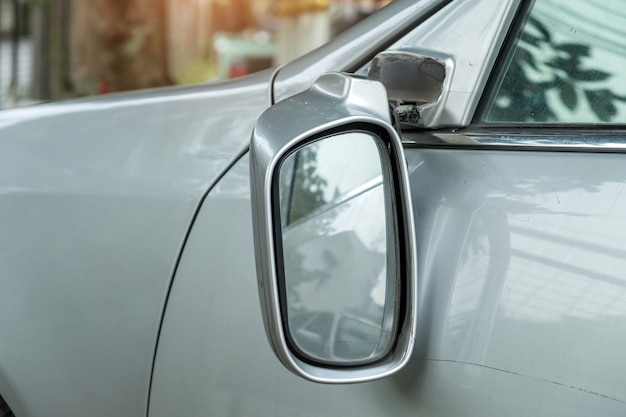 Car accident, car with a broken rearview mirror.