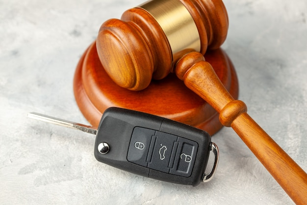 Car accident. judge gavel and car bleeding with alarm. car insurance solution. buying or selling a car by auction.