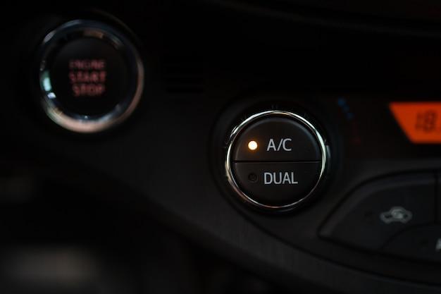 Car air conditioner button close up on black panel