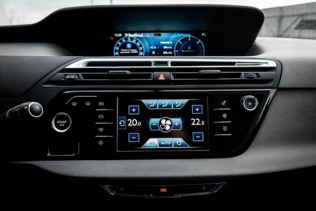 Car air conditioning panel on the luxury car console.