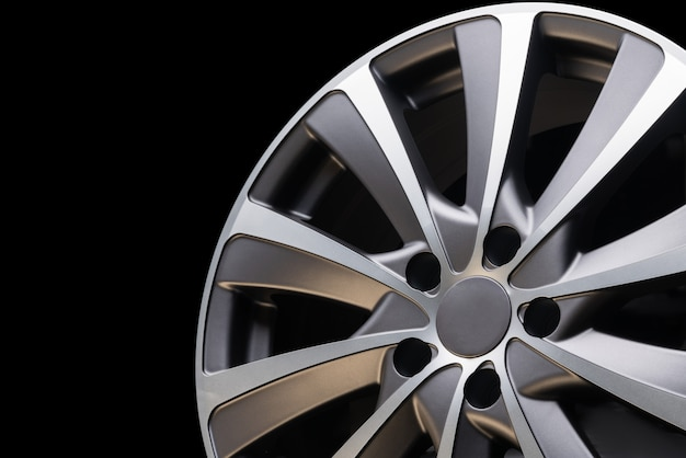 Car alloy wheel close up, beautiful design of smooth curved spokes, matte gray color
