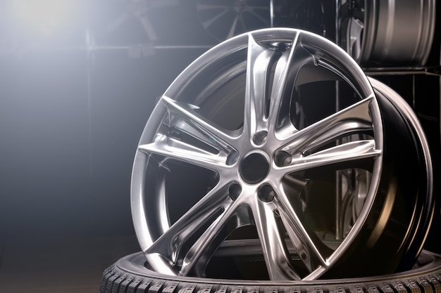 Car alloy wheel close up, beautiful design of smooth curved spokes
