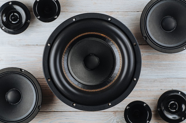 Car audio car speakers black subwoofer on a white wooden background close up