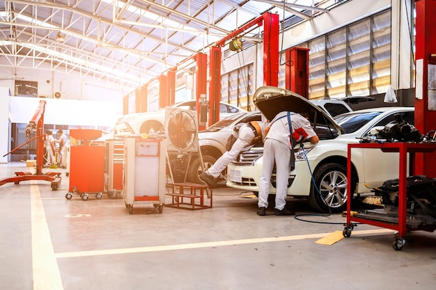 Car in automobile repair service center with soft-focus and over light in the background
