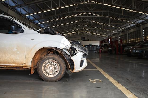 Car in automobile repair service center