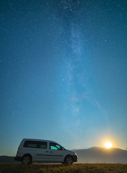 The car on the background of the milky way. night time