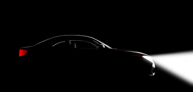 A car in a black studio with lights