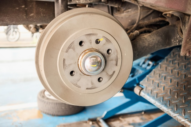 Car brake without wheels at auto repair shop
