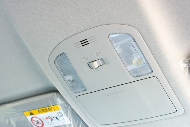 Car ceiling light with switch on interior of car.