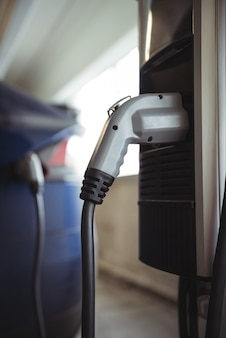 Car charger at electric vehicle charging station